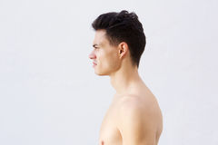 Νεαρός άνδρας γυμνοστήθων με δροσερό hairstyle Στοκ εικόνα με δικαίωμα ελεύθερης χρήσης