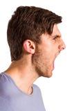 0 νεαρός άνδρας με να φωνάξει καλαμιών Στοκ Φωτογραφίες