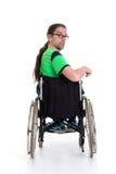 Νεαρός άνδρας με τα γυαλιά σε ένα wheelchairfrom η πλάτη Στοκ φωτογραφία με δικαίωμα ελεύθερης χρήσης