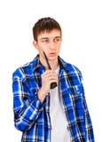 Νεαρός άνδρας με την ομιλούσα ταινία Walkie Στοκ Εικόνες