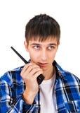 Νεαρός άνδρας με την ομιλούσα ταινία Walkie Στοκ φωτογραφίες με δικαίωμα ελεύθερης χρήσης