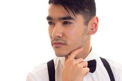 Νεαρός άνδρας με τον τόξο-δεσμό και suspenders Στοκ Φωτογραφίες