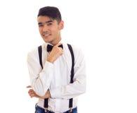 Νεαρός άνδρας με τον τόξο-δεσμό και suspenders Στοκ Φωτογραφία