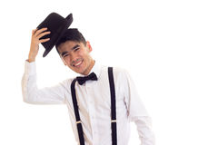 Νεαρός άνδρας με τον τόξο-δεσμό, suspenders και το καπέλο Στοκ Εικόνες