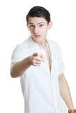 Νεαρός άνδρας που δείχνει ένα δάχτυλο Στοκ φωτογραφία με δικαίωμα ελεύθερης χρήσης