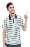 Νεαρός άνδρας που δείχνει σε κάτι με το δάχτυλό του Στοκ Εικόνες