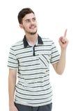 Νεαρός άνδρας που δείχνει σε κάτι με το δάχτυλό του Στοκ φωτογραφία με δικαίωμα ελεύθερης χρήσης