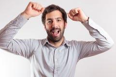 Νεαρός άνδρας που εκφράζουν happynes και χαρά Στοκ εικόνες με δικαίωμα ελεύθερης χρήσης