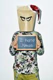 Νεαρός άνδρας που μισεί τα Χριστούγεννα Στοκ φωτογραφία με δικαίωμα ελεύθερης χρήσης