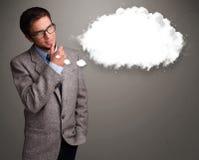 Νεαρός άνδρας που σκέφτεται για την ομιλία σύννεφων ή τη σκεπτόμενη φυσαλίδα με τη σπόλα Στοκ Φωτογραφία