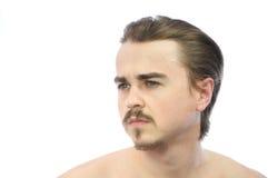 Νεαρός άνδρας που φαίνεται μακριά αριστερός Στοκ φωτογραφία με δικαίωμα ελεύθερης χρήσης