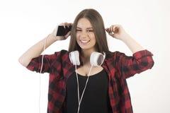 νεολαίες ακουστικών κοριτσιών στοκ φωτογραφίες με δικαίωμα ελεύθερης χρήσης