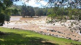 Νερά της πλημμύρας Oxenford, Queensland, Αυστραλία Στοκ φωτογραφία με δικαίωμα ελεύθερης χρήσης