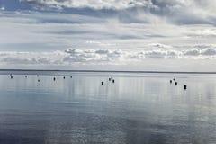 νεφελώδης ουρανός θάλασσας Στοκ Εικόνες