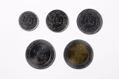 Νομίσματα Γιεμενιτών σε ένα άσπρο υπόβαθρο Στοκ Εικόνα