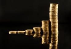 νομίσματα διαγραμμάτων χρυσά Στοκ φωτογραφίες με δικαίωμα ελεύθερης χρήσης