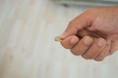 Νομίσματα εκμετάλλευσης ατόμων Στοκ εικόνα με δικαίωμα ελεύθερης χρήσης