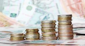 νομίσματα επιχειρησιακών διαγραμμάτων που γίνονται Στοκ φωτογραφίες με δικαίωμα ελεύθερης χρήσης