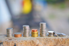 Νομίσματα η αρχή εκατομμύριο δολαρίων Στοκ Φωτογραφία