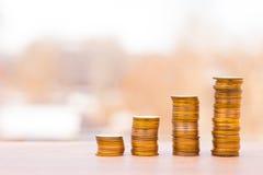 νομίσματα διαγραμμάτων Η έννοια της επιχειρησιακής αύξησης Στοκ φωτογραφία με δικαίωμα ελεύθερης χρήσης