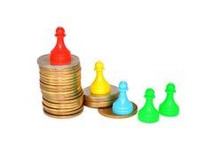 Νομίσματα και ειδώλια Στοκ εικόνα με δικαίωμα ελεύθερης χρήσης