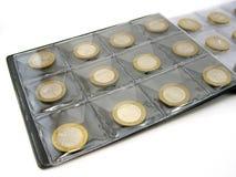 νομίσματα λευκωμάτων Στοκ φωτογραφίες με δικαίωμα ελεύθερης χρήσης