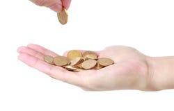 Νομίσματα με τα χέρια Στοκ φωτογραφία με δικαίωμα ελεύθερης χρήσης