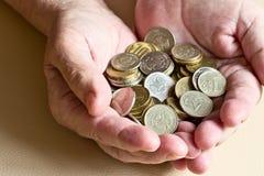 Νομίσματα στη διάθεση Στοκ Εικόνα