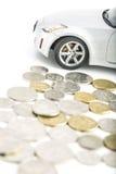 Νομίσματα στο λευκό με το αυτοκίνητο Στοκ Εικόνες