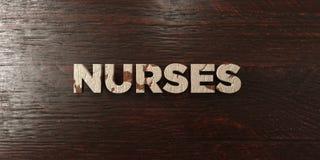 Νοσοκόμες - βρώμικος ξύλινος τίτλος στο σφένδαμνο - τρισδιάστατο δικαίωμα ελεύθερη εικόνα αποθεμάτων ελεύθερη απεικόνιση δικαιώματος