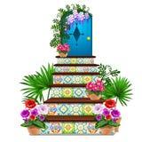 Ντεκόρ υπό μορφή μπλε ξύλινης πόρτας και βημάτων που κεραμώνονται με τις πολύχρωμες διακοσμήσεις, φρέσκα λουλούδια στα δοχεία που απεικόνιση αποθεμάτων