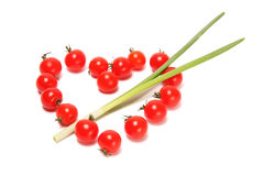 Ντομάτα καρδιών που διαπερνιέται με ένα βέλος Στοκ φωτογραφία με δικαίωμα ελεύθερης χρήσης