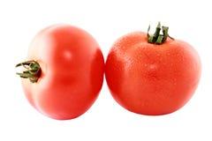 Ντομάτα δύο που απομονώνεται στην άσπρη διακοπή υποβάθρου Στοκ εικόνες με δικαίωμα ελεύθερης χρήσης