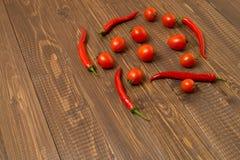 Ντομάτες και τσίλι κερασιών για Στοκ Εικόνες