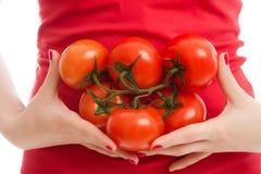 ντομάτες κοριτσιών Στοκ Εικόνες