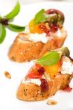ντομάτες κρέμας τυριών καναπεδακιών Στοκ φωτογραφία με δικαίωμα ελεύθερης χρήσης