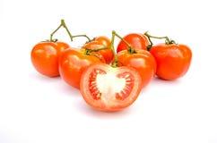 Ντομάτες Σύνολο και ένα μισό στο λευκό Στοκ Εικόνες
