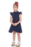 Ντροπαλό μικρό κορίτσι στο μπλε φόρεμα Στοκ Εικόνα
