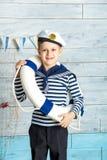 Ντυμένη αγόρι σανίδα σωτηρίας Στοκ Εικόνα