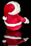Ντυμένος στο κόκκινο ένα santa παιχνιδιών Χριστουγέννων Στοκ Εικόνες