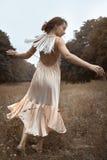 ντύνοντας απομονωμένη φόρεμα λευκή γυναίκα σακακιών Στοκ Φωτογραφία