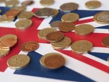Νόμισμα λιβρών, Ηνωμένο Βασίλειο πέρα από τη σημαία Στοκ εικόνες με δικαίωμα ελεύθερης χρήσης