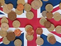 Νόμισμα λιβρών, Ηνωμένο Βασίλειο πέρα από τη σημαία Στοκ Εικόνα