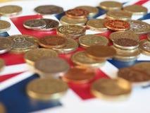 Νόμισμα λιβρών, Ηνωμένο Βασίλειο πέρα από τη σημαία Στοκ Εικόνες