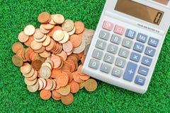 Νόμισμα και υπολογιστής Στοκ Εικόνα