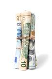 Νόμισμα που κυλιέται στους σωλήνες Στοκ Εικόνες