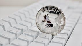 Νόμισμα Brexit με το χάρτη Στοκ Φωτογραφίες