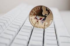 Νόμισμα Brexit με το χάρτη Στοκ Εικόνες