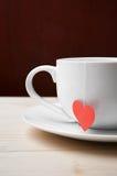 Νόστιμο φλυτζάνι του τσαγιού που γίνεται με την αγάπη Στοκ Εικόνες