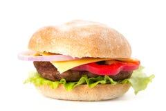 Νόστιμο χάμπουργκερ σε ένα άσπρο υπόβαθρο food unhealthy Στοκ εικόνες με δικαίωμα ελεύθερης χρήσης